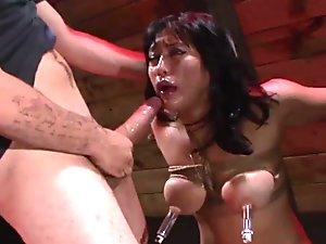Busty Asian Mia Li throat fucking in bondage dungeon